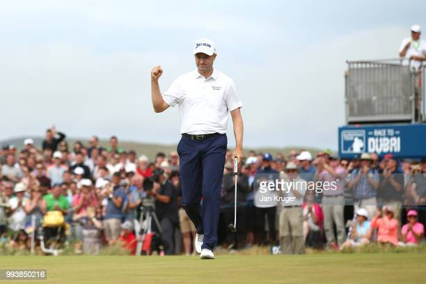Russell Knox of Scotland celebrates holing a birdie putt on the 18th green during the final round of the Dubai Duty Free Irish Open at Ballyliffin...