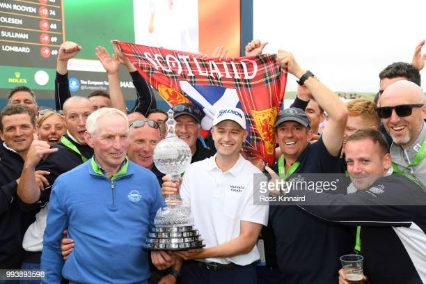 Russell Knox of Scotland celebrates with the trophy following his victory on the 18th green during a playoff at the end of the final round of the...