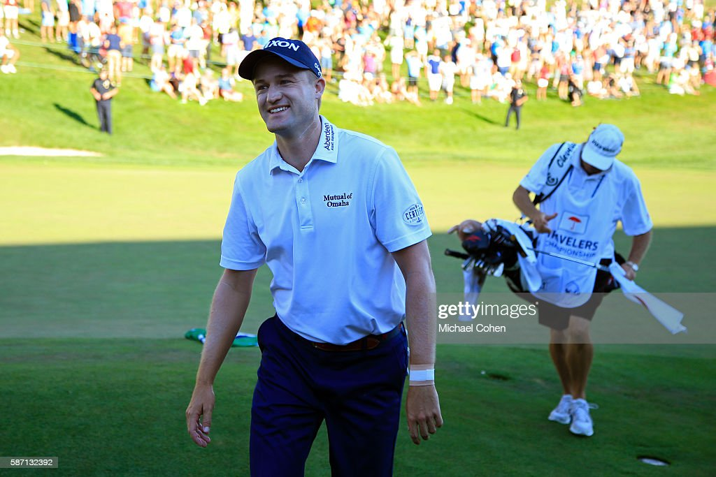 Russell Knox of Scotland comes off the 18th green after winning the Travelers Championship during the final round of the Travelers Championship at TCP River Highlands on August 7, 2016 in Cromwell, Connecticut.