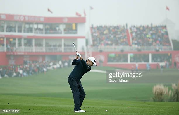 Russell Knox of Scotland hits his second shot on the 18th hole during the final round of the WGC HSBC Champions at the Sheshan International Golf...