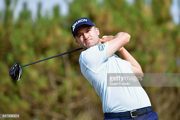 Russell Knox of Scotland hits his tee shot on the 13th during the first round on day one of the 145th Open Championship at Royal Troon on July 14...