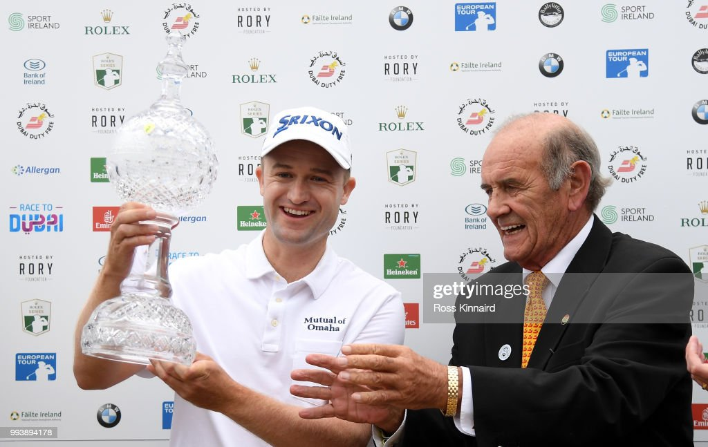 Russell Knox of Scotland is presented with the winners trophy by Colm McLoughlin, Executive Vice Chairman and CEO of Dubai Duty Free after his play-off win in the final round of the Dubai Duty Free Irish Open at Ballyliffin Golf Club on July 8, 2018 in Donegal, Ireland.