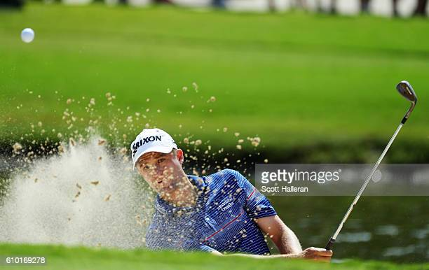 Russell Knox of Scotland plays a bunker shot on the 15th hole during the third round of the TOUR Championship at East Lake Golf Club on September 24...