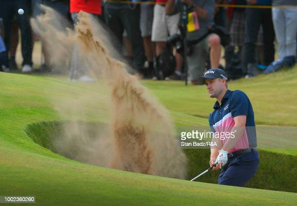 Russell Knox of Scotland plays a bunker shot on the sixth hole during the first round of the 147th Open Championship at Carnoustie Golf Club on July...
