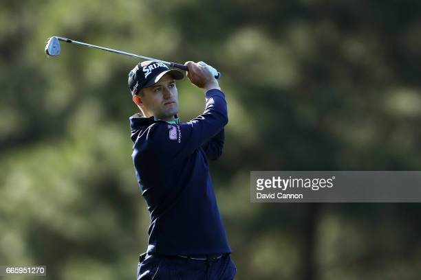 Russell Knox of Scotland plays a shot on the 14th hole during the second round of the 2017 Masters Tournament at Augusta National Golf Club on April...