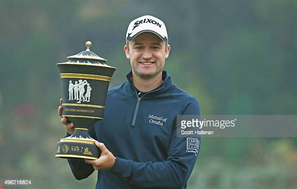 Russell Knox of Scotland poses with the trophy after his twostroke victory at the WGC HSBC Champions at the Sheshan International Golf Club on...
