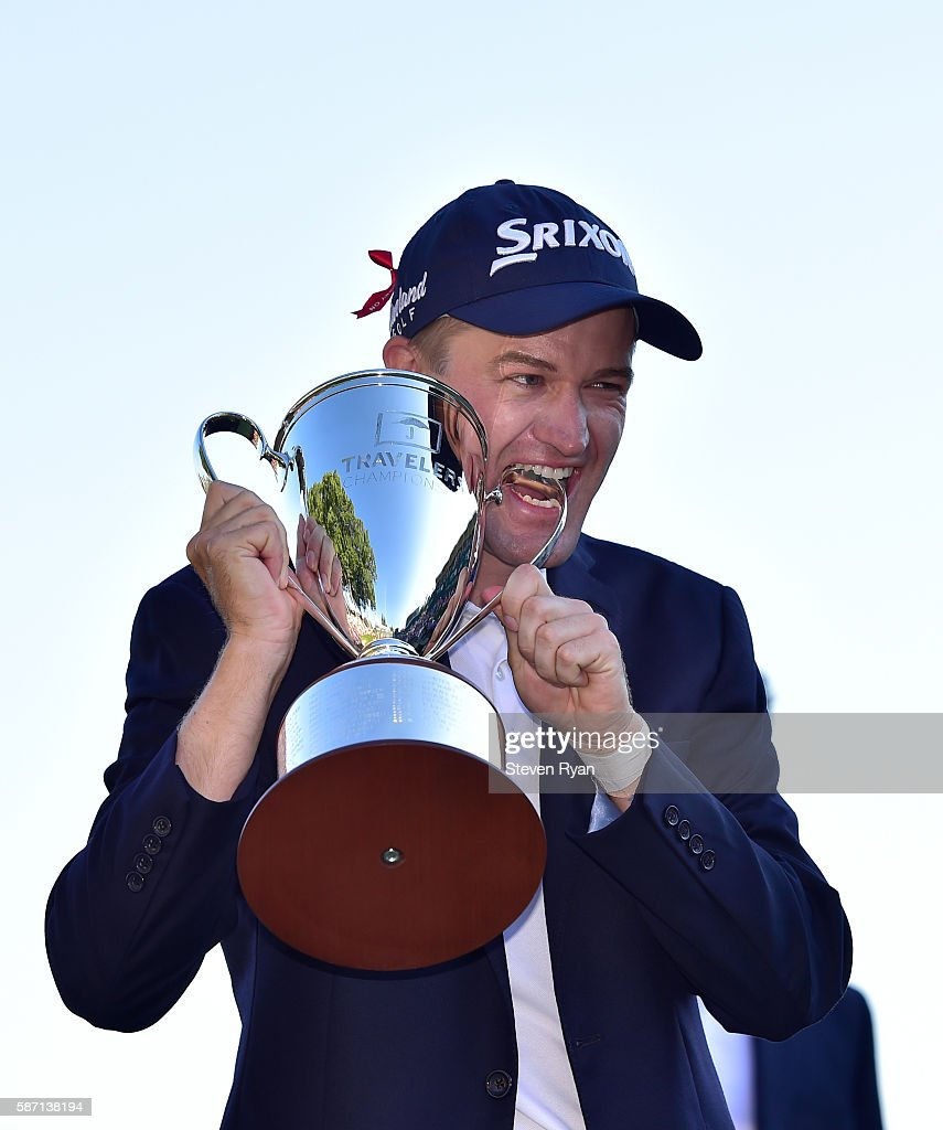 Russell Knox of Scotland poses with the trophy after winning the Travelers Championship at TCP River Highlands on August 7, 2016 in Cromwell, Connecticut.