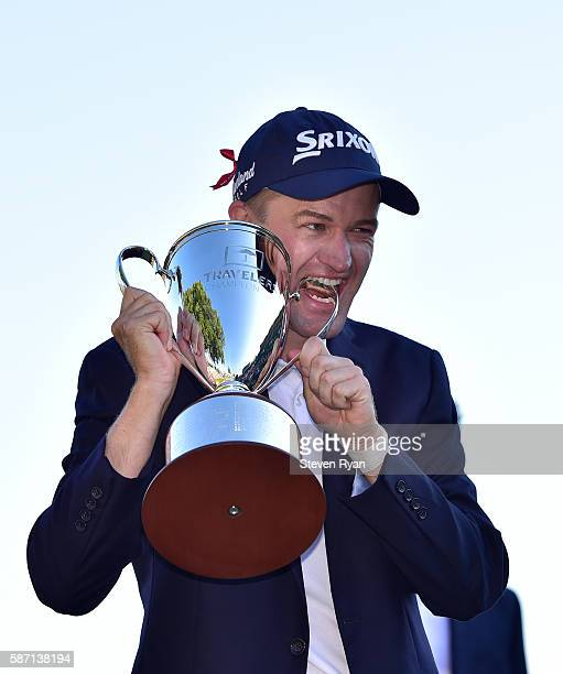 Russell Knox of Scotland poses with the trophy after winning the Travelers Championship at TCP River Highlands on August 7 2016 in Cromwell...