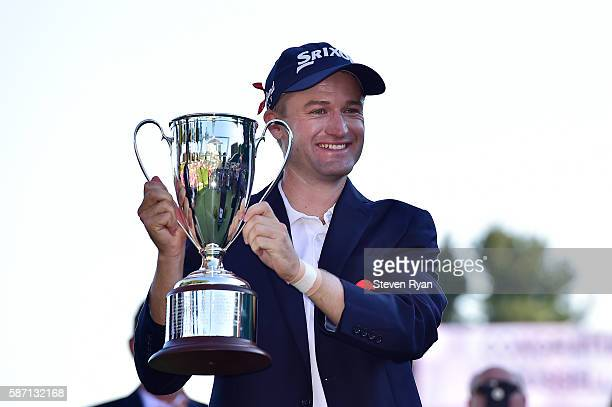 Russell Knox of Scotland poses with the trophy after winning the Travelers Championship during the final round of the Travelers Championship at TCP...