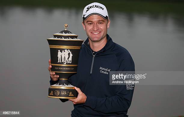Russell Knox of Scotland poses with the trophy aftre winning the WGC HSBC Champions at the Sheshan International Golf Club on November 8 2015 in...