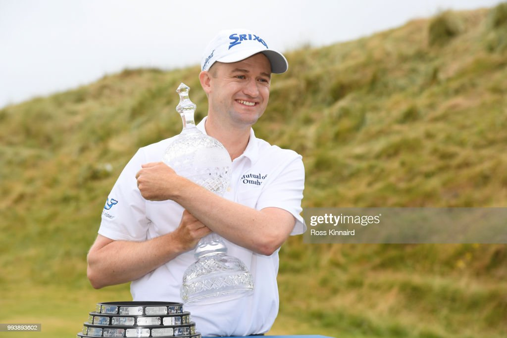 Russell Knox of Scotland poses with the trophy following his victory on the 18th green during a playoff at the end of the final round of the Dubai Duty Free Irish Open at Ballyliffin Golf Club on July 8, 2018 in Donegal, Ireland.