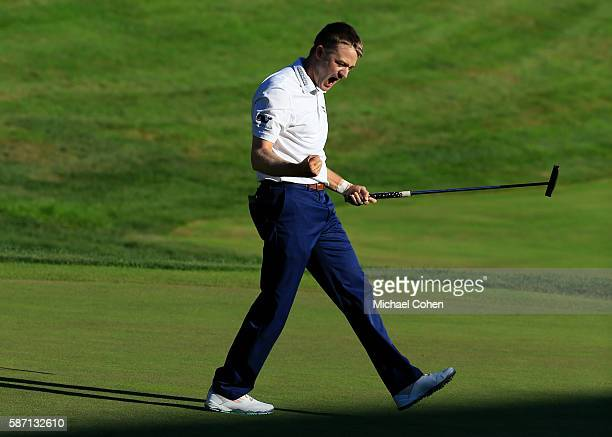 Russell Knox of Scotland reacts on the 18th green after winning the Travelers Championship during the final round of the Travelers Championship at...