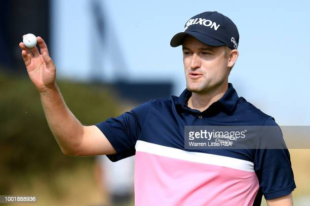 Russell Knox of Scotland reacts on the 6th green during round one of the 147th Open Championship at Carnoustie Golf Club on July 19 2018 in...