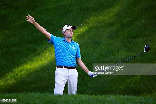 Russell Knox of Scotland reacts to his tee shot on the 15th hole during the second round of the Travelers Championship at the TPC River Highlands on...