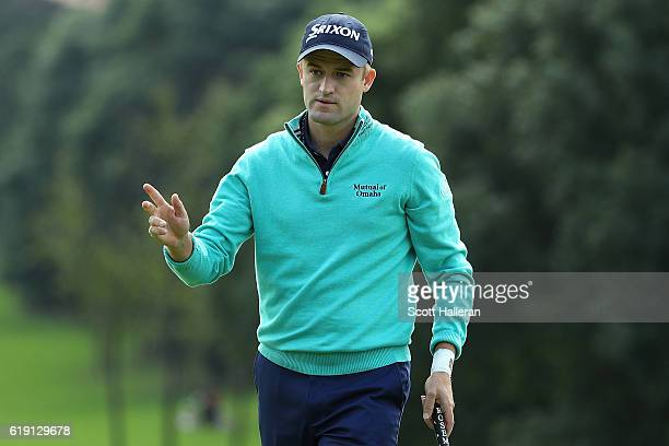 Russell Knox of Scotland waves to the crowd on the 1st hole during day four of the WGC HSBC Champions at Sheshan International Golf Club on October...