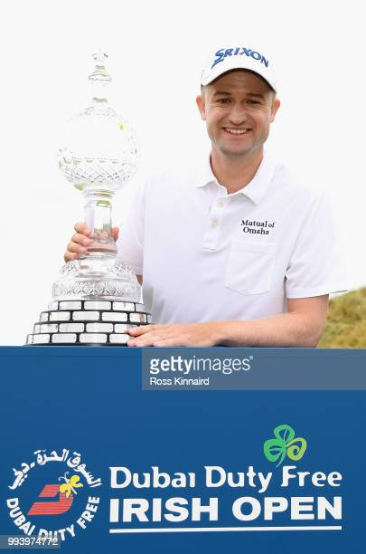 Russell Knox of Scotland with the winners trophy after his playoff win in the final round of the Dubai Duty Free Irish Open at Ballyliffin Golf Club...