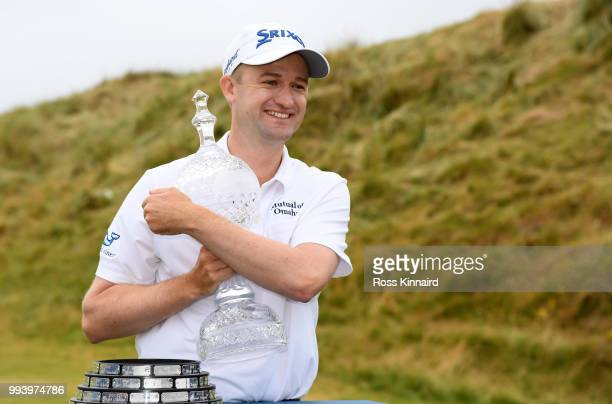 Russell Knox of Scotland with the winners trophy after his play-off win in the final round of the Dubai Duty Free Irish Open at Ballyliffin Golf Club...