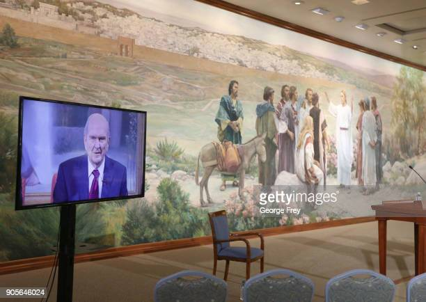 Russell M Nelson speaks via television from the historic Mormon Salt Lake Temple to members of the Church of Jesus Christ of Latter Day Saints after...