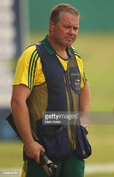 Russell Mark of Australoia looks dejected after failing to place in the men's double trap at the Dr Karni Singh Shooting Range during day four of the...
