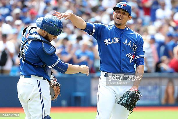 TORONTO ON JULY 2 Russell Martin and Roberto Osuna celebrate the win as the Toronto Blue Jays beat the Cleveland Indians 96 to end their 14 game...