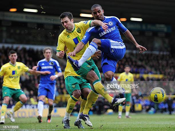 Russell Martin of Norwich and Florent Malouda of Chelsea clash during the Barclays Premier League match between Norwich City and Chelsea at Carrow...