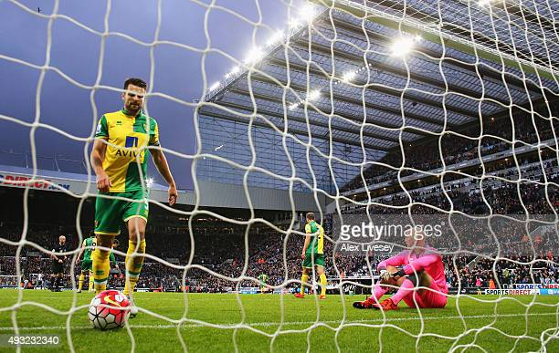 Russell Martin of Norwich City and John Ruddy of Norwich City look dejected after conceding a goal during the Barclays Premier League match between...