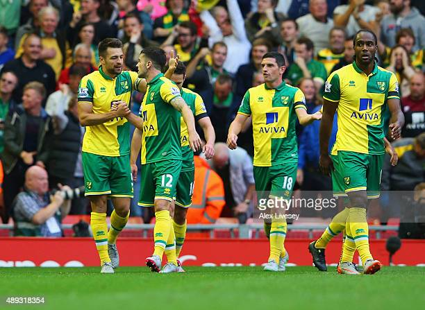 Russell Martin of Norwich City celebrates with Robbie Brady as he scores their first and equalising goal during the Barclays Premier League match...