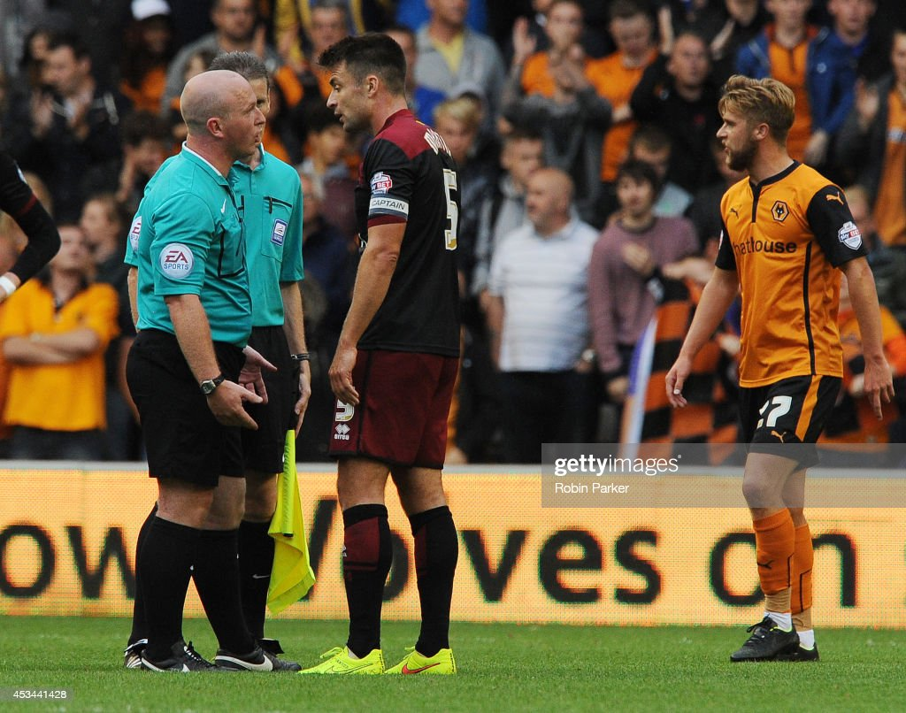 Russell Martin of Norwich City confronts Referee Simon Hooper at the end of the Sky Bet Championship match between Wolverhampton Wanderers and Norwich City at the Molineux Stadium on August 10, 2014 in Wolverhampton, England.