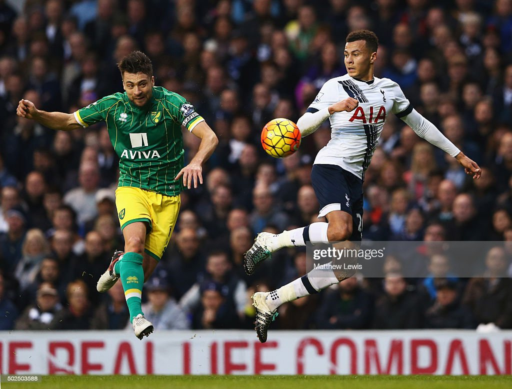 Russell Martin of Norwich City is challenged by Dele Alli of Tottenham Hotspur during the Barclays Premier League match between Tottenham Hotspur and Norwich City at White Hart Lane on December 26, 2015 in London, England.