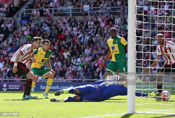 Russell Martin of Norwich City scores his side's first goal past Costel Pantilimon of Sunderland during the Barclays Premier League match between...