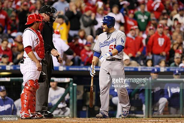 Russell Martin of the Los Angeles Dodgers argues with home plate umpire Ted Barrett after Martin was called out on strikes in the top of the sixth...