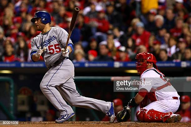 Russell Martin of the Los Angeles Dodgers hits a RBI single in the top of the fourth inning against of the Philadelphia Phillies in Game Four of the...