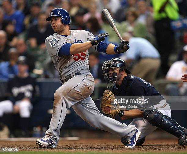 Russell Martin of the Los Angeles Dodgers hits a run-scoring single in the 7th inning against the Milwaukee Brewers on May 15, 2008 at Miller Park in...