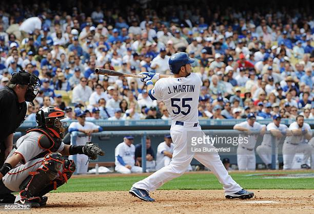 Russell Martin of the Los Angeles Dodgers hits a two RBI single in the fourth inning against the San Francisco Giants on Opening Day at Dodger...