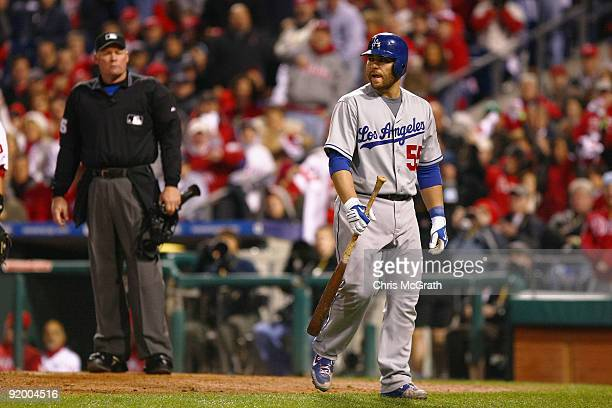 Russell Martin of the Los Angeles Dodgers walks back to the dugout dejected after he argued with home plate umpire Ted Barrett after Martin was...