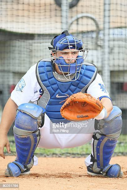 Russell Martin of the Los Angeles Dodgers warms up the starting pitcher prior to the game between the Florida Marlins and the Los Angeles Dodgers at...