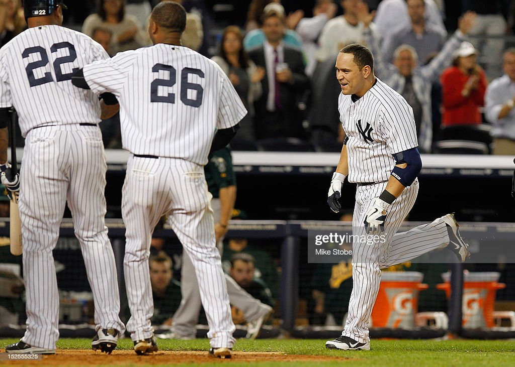 Russell Martin #55 of the New York Yankees celebrates after hitting a walk-off home run in the 10th inning against the Oakland Athletics at Yankee Stadium on September 21, 2012 in the Bronx borough of New York City. The Yankees defeated the Athletics 2-1.