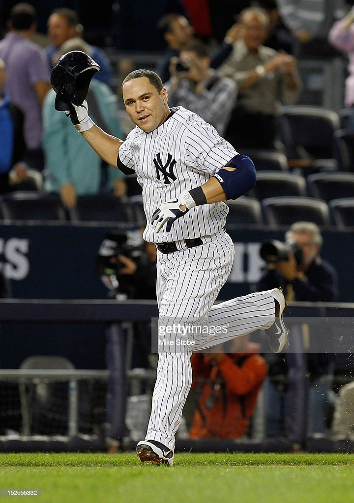 Russell Martin #55 of the New York Yankees celebrates after hitting a walk-off home run in the 10th inning against the Oakland Athletics at Yankee Stadium on September 21, 2012 in the Bronx borough of New York City. The Yankees defeated the Athletics 2-1 in 10 innings.