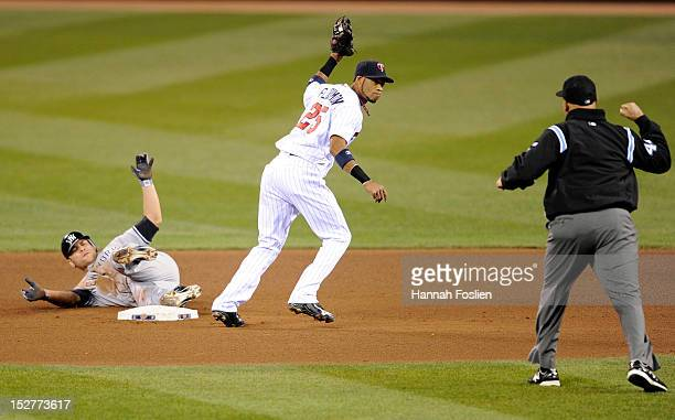 Russell Martin of the New York Yankees reacts as second base umpire Kerwin Danley calls him out after Pedro Florimon of the Minnesota Twins caught...