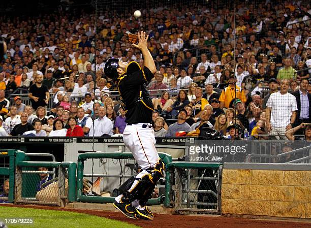 Russell Martin of the Pittsburgh Pirates catches the second out of the ninth inning against the Los Angeles Dodgers during the game on June 14 2013...