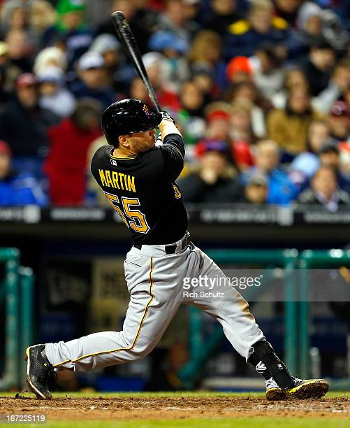 Russell Martin of the Pittsburgh Pirates hits a solo home run during the fifth inning against the Philadelphia Phillies in a MLB baseball game on...