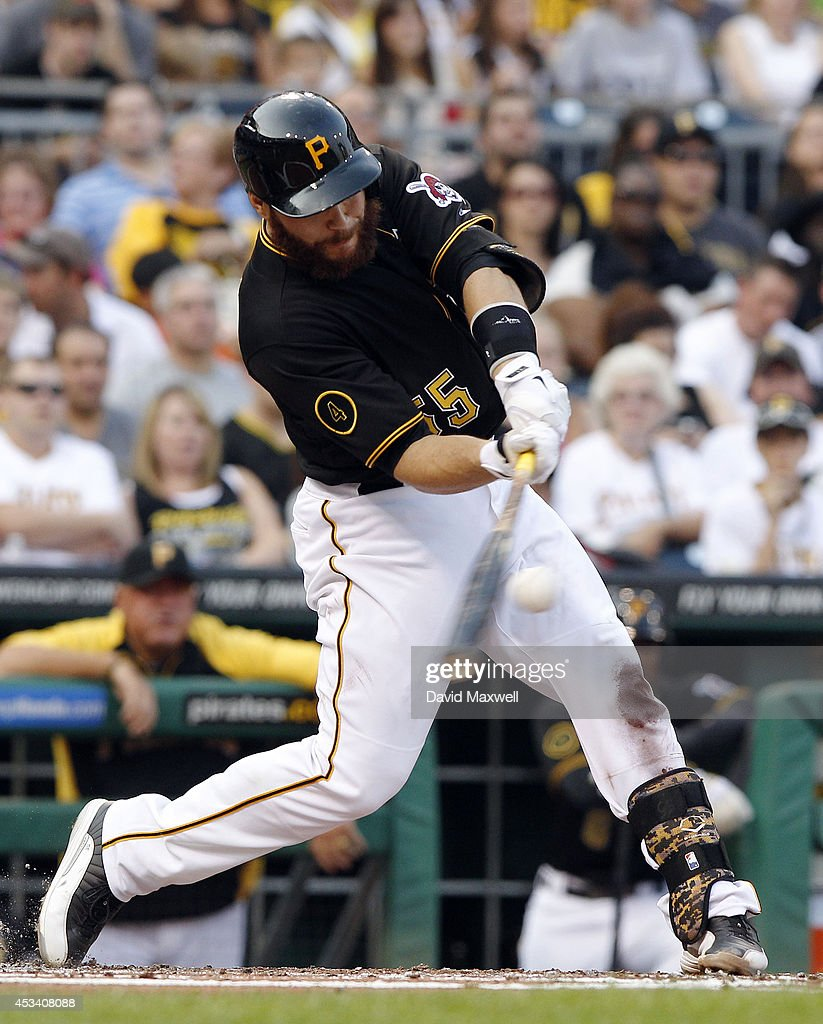 Russell Martin #55 of the Pittsburgh Pirates hits an RBI single to score Josh Harrison #5 against the San Diego Padres during the first inning of their game on August 9, 2014 at PNC Park in Pittsburgh, Pennsylvania.