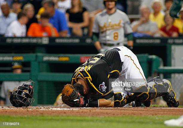 Russell Martin of the Pittsburgh Pirates reacts after being injured in the first inning against the Oakland Athletics during the game on July 9 2013...