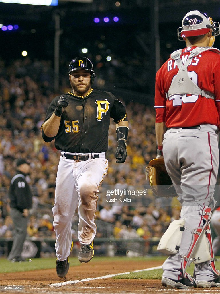 Russell Martin #55 of the Pittsburgh Pirates scores on a sacrifice fly in the seventh inning against the Washington Nationals during the game at PNC Park May 24, 2014 in Pittsburgh, Pennsylvania.