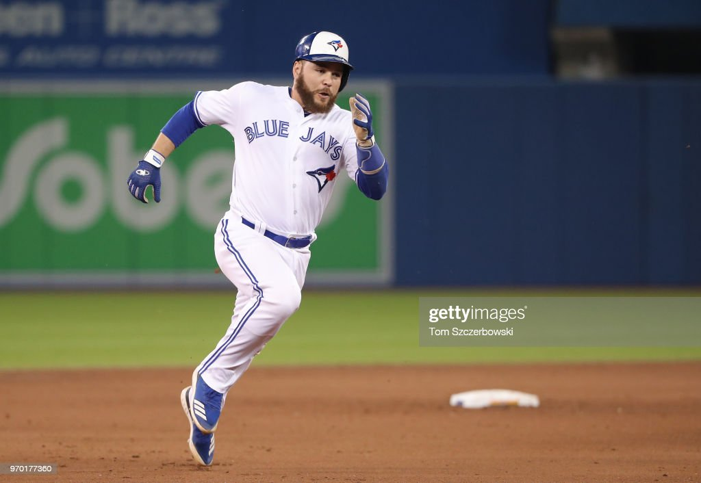 Russell Martin #55 of the Toronto Blue Jays advances from first base to third base on a double by Aledmys Diaz #1 in the eighth inning during MLB game action against the Baltimore Orioles at Rogers Centre on June 8, 2018 in Toronto, Canada.
