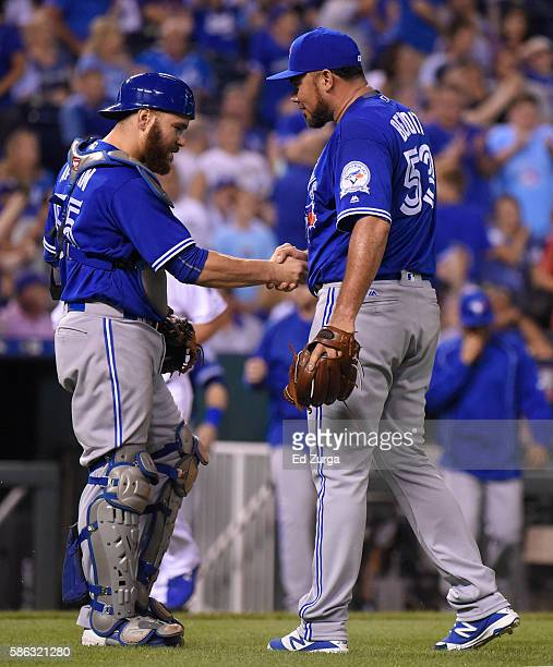 Russell Martin of the Toronto Blue Jays and Joaquin Benoit celebrate a 43 win over the Kansas City Royals at Kauffman Stadium on August 5 2016 in...