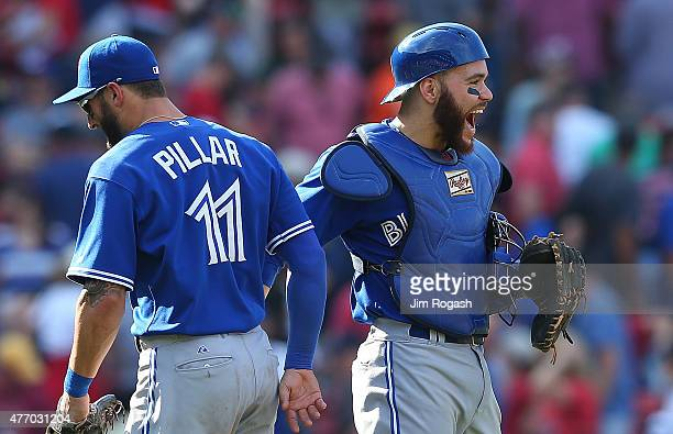 Russell Martin of the Toronto Blue Jays celebrates a 54 win against the Boston Red Sox in eleven innings at Fenway Park on June 13 2015 in Boston...