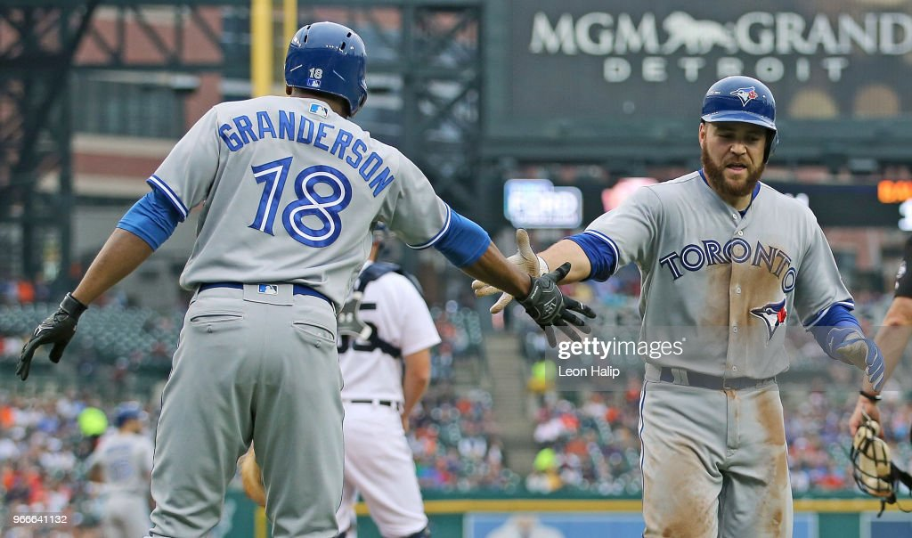 Russell Martin #55 of the Toronto Blue Jays celebrates a solo home run with teammate Curtis Granderson #18 of the during the sixth inning of the game against the Detroit Tigers at Comerica Park on June 3, 2018 in Detroit, Michigan.