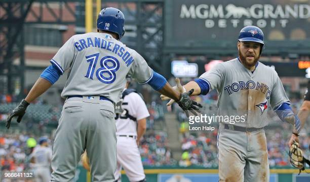 Russell Martin of the Toronto Blue Jays celebrates a solo home run with teammate Curtis Granderson of the during the sixth inning of the game against...