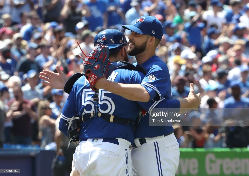 Russell Martin #55 of the Toronto Blue Jays celebrates a victory with Ryan Tepera #52 over the Atlanta Braves at Rogers Centre on June 20, 2018 in Toronto, Canada.
